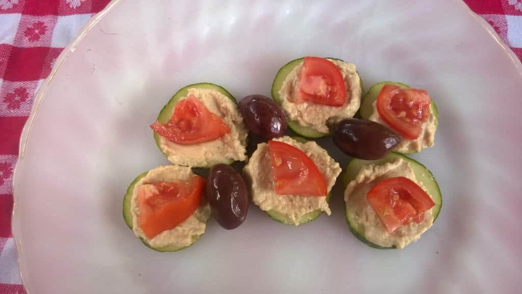 Cucumber, tomatoes, hummus and olives